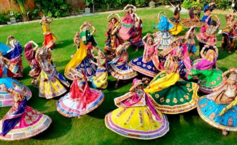 A capture from garba druing Navratri in Gujarat. Colourful costumes, dancing around the goddess Durga Maa, and live traditional music